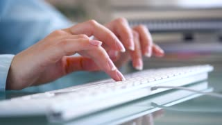 Woman office worker typing on the keyboard and works with taxes