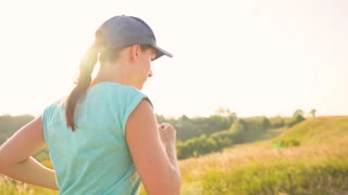 Woman runs outdoors at sunset