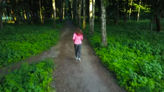 Woman runs through the forest