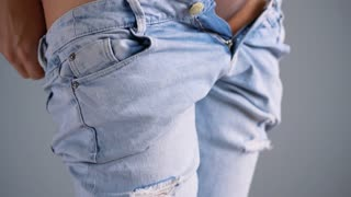 Young woman is wearing blue jeans