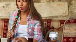 Woman smoking a hookah