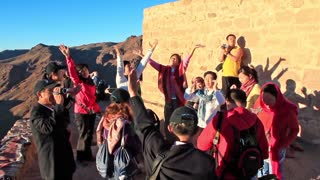 Pilgrims from China on Moses Mountain, Sinai Peninsula, Egypt. Invocatory prayer. Mount Sinai, also known as Mount Horeb, is a mountain in the Sinai Peninsula of Egypt that is the traditional and most accepted identification of Biblical Mount Sinai