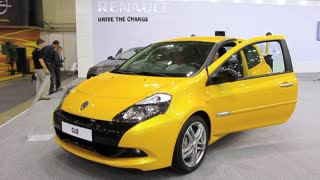 KIEV, UKRAINE, MAY 27, 2012: Yellow Renault Clio at yearly automotive-show