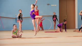 KIEV, UKRAINE, JUNE 9, 2012: Young girls gymnasts in gym at final examination in Deriugina school in Kiev, Ukraine, June 9, 2012