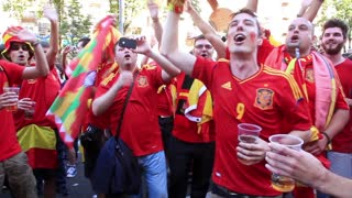 "KIEV, UKRAINE - 1 JULY 2012: Spanish football fans in red shirts before final match of European Football Championship ""EURO 2012"" (Spain vs Italy), Kiev, Ukraine, July 1, 2012."
