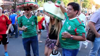 "KIEV, UKRAINE - 1 JULY 2012: Mexican football fans in red shirts before final match of European Football Championship ""EURO 2012"" (Spain vs Italy), Kiev, Ukraine, July 1, 2012."