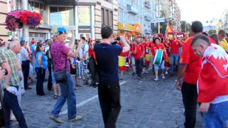 KIEV, UKRAINE - 1 JULY 2012: Spanish football fans in red shirts before final match of European Football Championship
