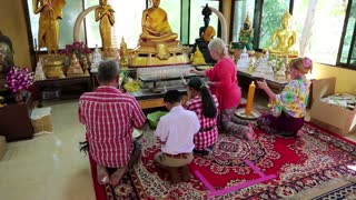 THAILAND, PATTAYA, APRIL 1, 2014: People inside Buddhist temple on Pratumnak Hill near Big Golden Buddha statue in Pattaya, Thailand
