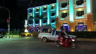 THAILAND, PATTAYA, MARCH 31, 2014: Road traffic on the Beach Road near motel with blue night illumination in Pattaya, Thailand