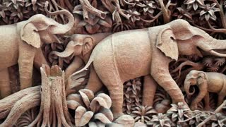 THAILAND, BANGKOK, APRIL 05, 2014: Picture with elephants made of one piece of teak wood at a teak factory in Thailand.