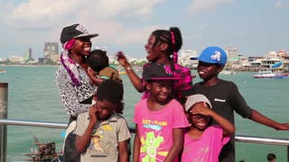 THAILAND, PATTAYA, APRIL 7, 2014: Afro-American family from Pennsylvania state sings a song on the shore of the Gulf of Siam in Pattaya, Thailand. Editorial video. Short version (1 minute)