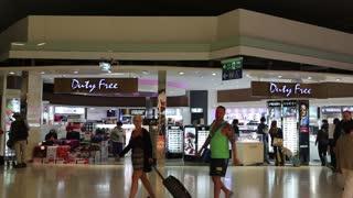 THAILAND, BANGKOK, APRIL 13, 2014: People in duty free store inside Bangkok international airport in Thailand