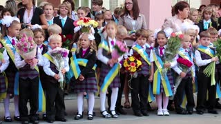 UKRAINE, KIEV, SEPTEMBER 1, 2012: Beginning of school year. Children stand near the school in Kiev, Ukraine