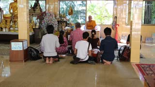 THAILAND, PATTAYA, APRIL 1, 2014: People in Buddhist temple on Pratumnak Hill near Big Golden Buddha statue in Pattaya, Thailand