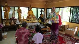 THAILAND, PATTAYA, APRIL 1, 2014: People inside Buddhist temple on Pratumnak Hill near Big Golden Buddha statue in Pattaya, Thailand