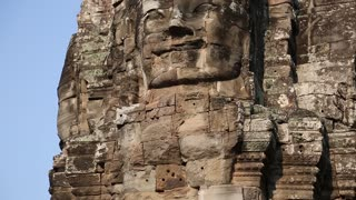 Bas-relief of the face in Bayon - ancient Khmer temple in Angkor Thom temple complex in Cambodia