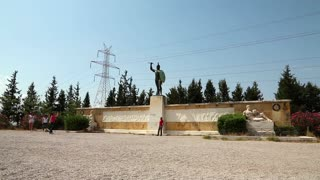 GREECE, JUNE 7, 2013: People near monument to the Battle of Thermopylae and statue of King Leonidas, Greece
