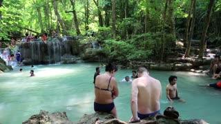 THAILAND, KANCHANABURI PROVINCE, APRIL 5, 2014: People in Erawan National Park and Erawan Waterfall in Kanchanaburi Province, western Thailand