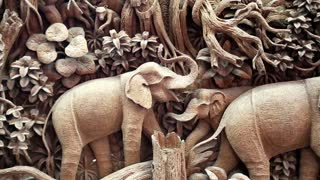 THAILAND, BANGKOK, APRIL 05, 2014: Picture with elephants made of one piece of teak wood at a teak factory in Thailand
