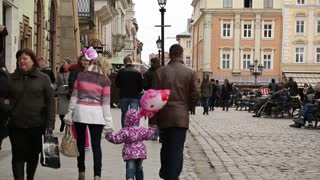 UKRAINE, LVIV, APRIL 5, 2015: People near the Lviv Town Hall on the Market Square - is a central square of the city of Lviv in Western Ukraine