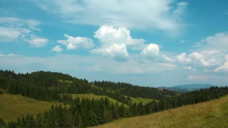 4K Timelapse of clouds and beautiful green mountains with coniferous trees (ultra-high definition (UHD, 4096x2304)). Video without birds and defects