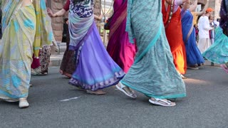 UKRAINE, KIEV, MAY 25, 2013: Women in Hindu traditional colorful costumes, dancing and singing Hare Krishna mantra on the main street in Kiev, Ukraine
