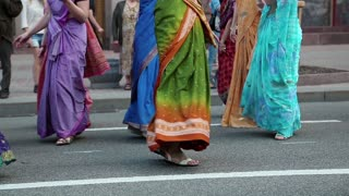 UKRAINE, KIEV, MAY 25, 2013: Women in Hindu traditional colorful costumes, dancing and singing Hare Krishna mantra on the main street in Kiev, Ukraine