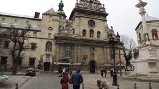 UKRAINE, LVIV, APRIL 5, 2015: People near the Bernardine church and monastery in old town of Lviv, Western Ukraine
