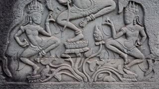 Bas-relief on the ancient wall in Angkor Thom temple complex in Cambodia. Apsara dance