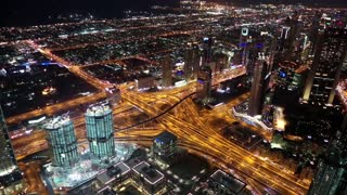 View on the night Sheikh Zayed road from Burj Khalifa skyscraper in Dubai, UAE.  Burj Khalifa - megatall skyscraper and currently the tallest structure in the world, 829,8 m or 2,722 ft