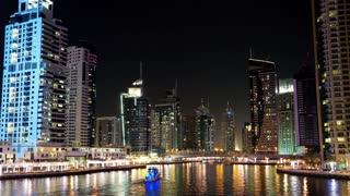 4K Dubai Marina night time lapse, United Arab Emirates. Dubai Marina - the largest man-made marina in the world. Dubai Marina is a canal city, carved along a 3 km stretch of Persian Gulf shoreline