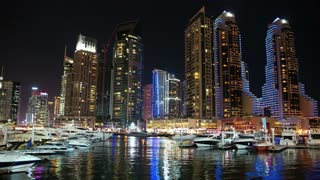 4K Dubai Marina night time lapse, United Arab Emirates. Dubai Marina - the largest man-made marina in the world. Dubai Marina is a canal city, carved along a 3 km stretch of Persian Gulf shoreline