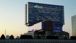ABU DHABI, FEBRUARY 4, 2016: Medical helicopter flies to Cleveland clinic in Abu Dhabi, Al Maryah island, United Arab Emirates. Abu Dhabi - capital and second most populous city in UAE, after Dubai