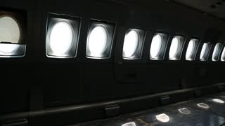 Aircraft windows. Inside the airplane. Empty interior of old airliner. Interior of aircraft without passenger seats