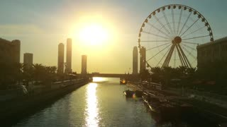 Al Qasba canal and ferris wheel in Sharjah city, United Arab Emirates. Sharjah - third largest and third most populous city in UAE, after Dubai, and the capital of the emirate of Sharjah