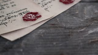 Antique letters with official heraldic stamps. Two ancient manuscripts. Old papers lies on the table