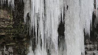 Beautiful frozen waterfall in Kamianets-Podilskyi city in western Ukraine