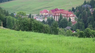 Beautiful green hills and cottages with red roofs