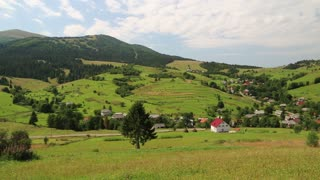 Beautiful green hills and rural settlement in  Carpathians, Ukraine