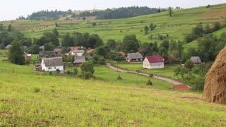 Beautiful green hills and village in Carpathian mountains, Ukraine