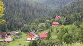 Beautiful green mountains and cottages with red roofs