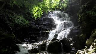 Beautiful waterfall with sunlight in Carpathian Mountains
