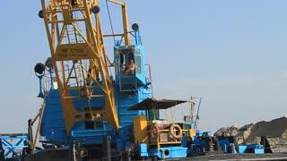 Big port crane on the river