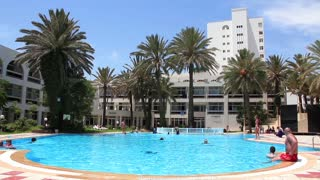 Blue open-air swimming pool in hotel area, Sousse, Tunisia