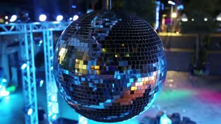 Blue spinning glitterball near dancefloor