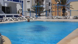 Blue swimming pool in hotel