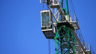 Building crane on blue background