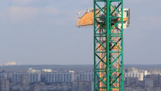 Building cranes. Yellow and green