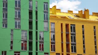 Buildings with green and yellow facades