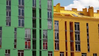 Buildings with green, yellow and red facades